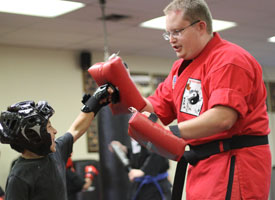 instructor allen porter shows a student how to hit two targets in self defense class