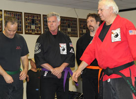 master tom georgion teaches lesson to adult class